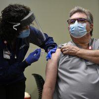 old man taking vaccine
