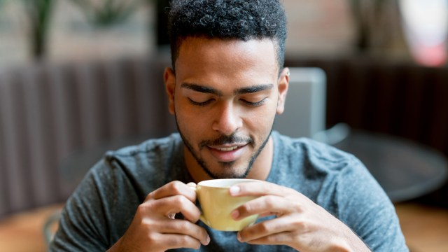 young man drinking coffe